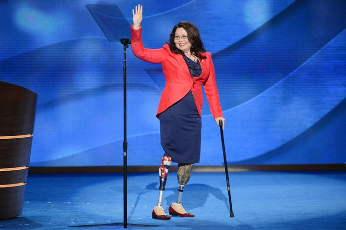 Lt. Col. Tammy Duckworth, candidate for the US House of Representatives for Illinois and former Assistant Secretary of the US Department of Veterans Affairs leaves the stage after addressing the Democratic National Convention. (Andrew Geraci/ The Washington Times)