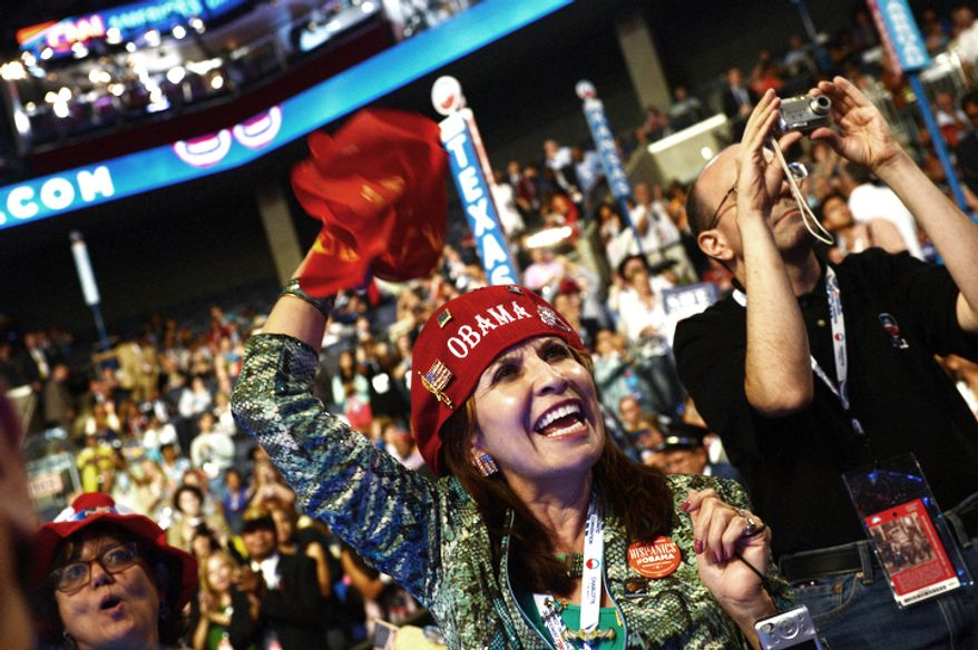 New Mexico delegate Priscilla Chavez, of Las Cruces, N.M. cheers on the first night of the Democratic National Convention. (Barbara Salisbury/ The Washington Times)