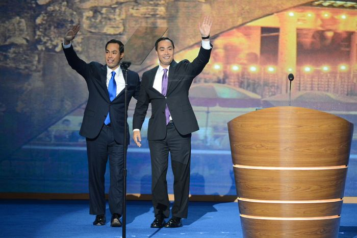 Joaquin Castro, right,  brother of Julian Castro, left, Mayor of San Antonio, Tex. introduces him for the keynote address on the opening night of the Democratic National Convention. (Andrew Geraci/ The Washington Times)
