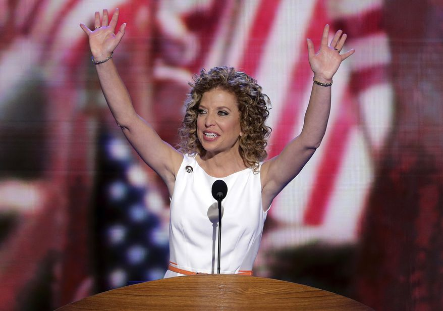 Democratic National Committee Chairwoman Rep. Debbie Wasserman Schultz of Florida waves Sept. 4, 2012, as she opens the party's convention in Charlotte, N.C. (Associated Press)
