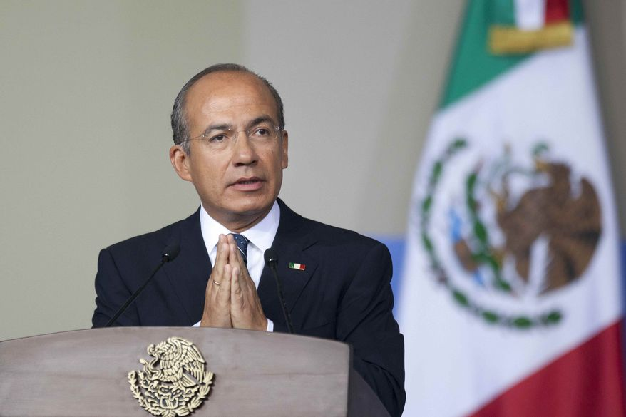 Mexican President Felipe Calderon delivers his state-of-the-nation address to Congress in Mexico City on Monday, Sept. 3, 2012. (AP Photo/Alexandre Meneghini)