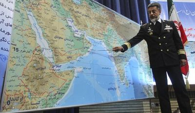 ** FILE ** Adm. Habibollah Sayyari, Iran's naval chief, briefs the media on Thursday, Dec. 22, 2011, during a press conference in Tehran on an upcoming naval exercise. (Associated Press/Fars News Agency)