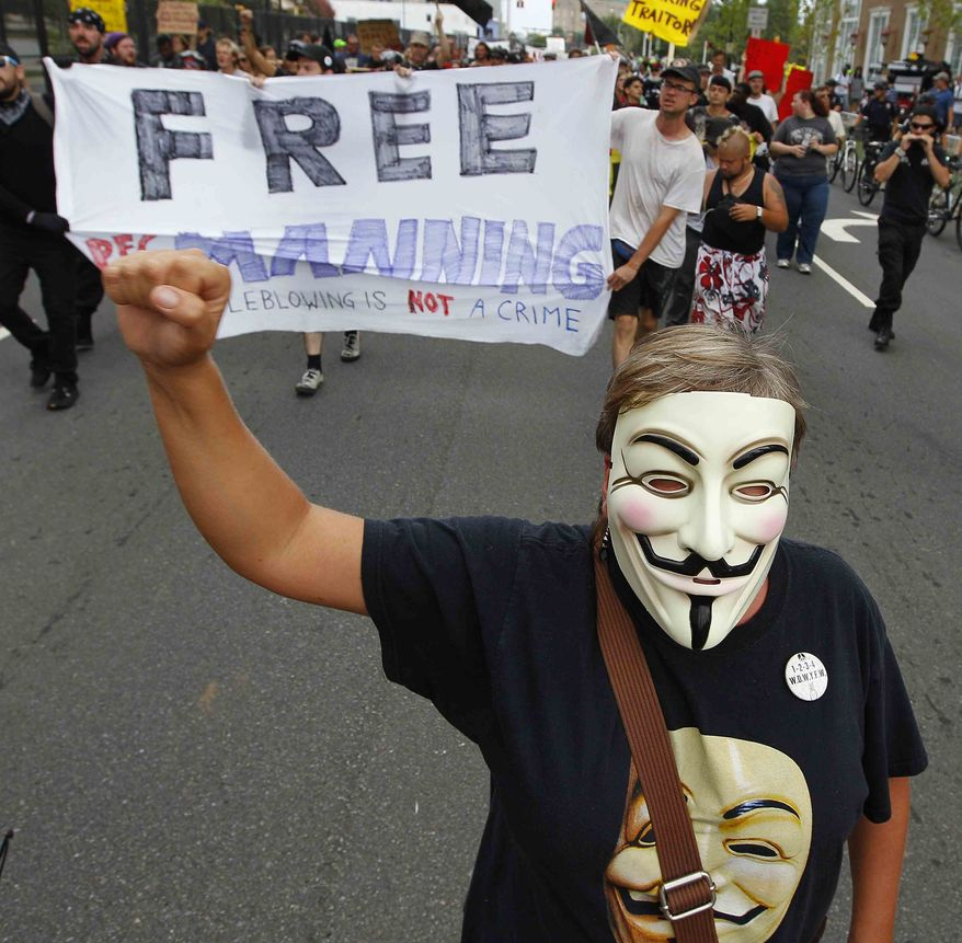 Occupy demonstrators move through downtown in an unscheduled protest march on Tuesday, Sept. 4, 2012, in Charlotte, N.C. The Democratic National Convention begins today. (AP Photo/Chuck Burton)