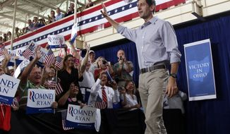 Rep. Paul Ryan, the Republican vice presidential nominee, arrives at a campaign event at the Westlake Recreation Center in Westlake, Ohio, on Tuesday, Sept. 4, 2012. (AP Photo/Mary Altaffer)