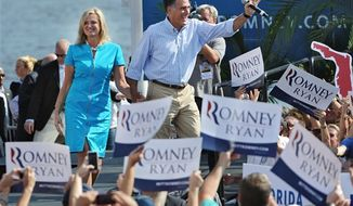 Republican presidential nominee Mitt Romney and his wife Ann take the stage Saturday, Sept. 1, 2012 in Jacksonville, Fla. (Associated Press/The Florida Times-Union, Bob Mack)