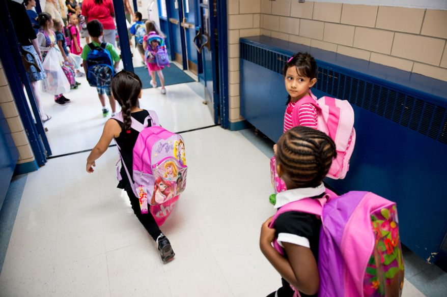 Children make their way to class on the first day back to school at North Springfield Elementary School, Springfield, Va., Tuesday, September 4, 2012. (Andrew Harnik/The Washington Times)