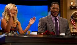 "Former football player Michael Strahan, right, sits with Kelly Ripa on the set of the newly named ""Live! with Kelly and Michael"" on Tuesday, Sept. 4, 2012 in New York. Strahan joined the popular morning show as a permanent co-host on Tuesday, fulfilling a joking prophecy he made to Regis Philbin more than four years ago. (Photo by Charles Sykes/Invision/AP Images)"