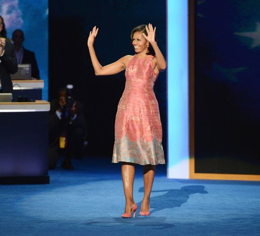 First lady Michelle Obama got rave reviews for the Tracy Reese-designed dress she wore for a speech lauding her husband at the Democratic National Convention on its opening night Tuesday at Time Warner Arena in Charlotte, N.C. (Andrew Geraci/The Washington Times)