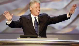 President Bill Clinton gestures as he is introduced at the Democratic National Convention in the Staples Center in August 2000 in Los Angeles. Not every member of the Democratic Party remains enthralled with the contentious and sometimes chaotic Clinton years. (Associated Press)