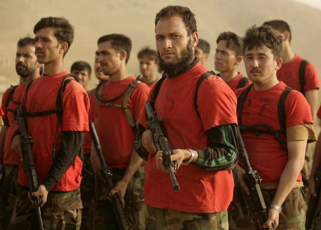 **FILE** Afghan Commandos stand in formation during an instructors' training course at their base in Afghanistan's Wardak province on Oct. 4, 2009. (Associated Press)