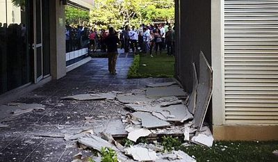 This photo posted to an Instagram account belonging to a person identified as Jose Pablo Pineda, an eyewitness at the scene, shows damage at an office building in San Jose, Costa Rica, after a magnitude-7.6 earthquake struck on Wednesday, Sept. 5, 2012. (AP Photo/Jose Pablo Pineda via Instagram)