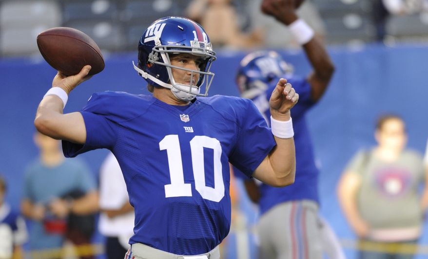 This Aug. 29, 2012 photo, New York Giants quarterback Eli Manning (10) warms up before a preseason NFL football game against the New England Patriots  in East Rutherford, N.J.  Manning is no longer living in the shadow of his big brother. The New York Giants quarterback enters the kickoff to the NFL season against the Dallas Cowboys on Wednesday night as a two-time Super Bowl MVP. He's now unquestionably among the league's elite after leading Tom Coughlin's team to two titles in five seasons, and a third title is a distinct possibility with the 31-year-old seemingly getting better coming off a career season. (AP Photo/Bill Kostroun)