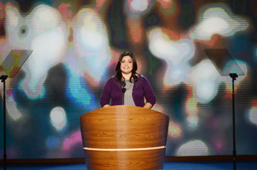Benita Veliz, a student who had her deportation halted under President Obama's non-deportation policies, addresses the Democratic National Convention at the Time Warner Arena in Charlotte, N.C., on Sept. 5, 2012. (Andrew Geraci/The Washington Times)