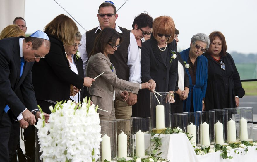Israel's deputy Prime Minister Silvan Shalom and relatives light candles during a commemoration ceremony for the assassination victims of the Olympic games in Munich in 1972, at the former airbase in Fuerstenfeldbruck, southern Germany, Wednesday, Sept. 5, 2012. Relatives of Israelis slain by Palestinian gunmen during the games and survivors of the attack are marking its 40th anniversary with German politicians and Jewish leaders at the air base where most of the 12 victims died. Also five terrorists were killed in the failed liberation attempt. (AP Photo/dapd, Lennart Preiss)