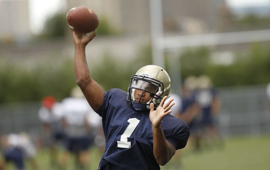 Navy quarterback Trey Miller during a training session at the Aviva Stadium, Dublin, Ireland, Thursday, Aug. 30, 2012.  American college football team Notre Dame play the Navy team on Saturday in Dublin.  (AP Photo/Peter Morrison)