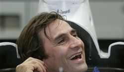 ** FILE ** This Thursday Nov. 23, 2006, file photo shows two-time CART champion Alex Zanardi, who lost both of his legs in a crash over five years ago, inside the modified cockpit of his BMW-Sauber C24-B, as he becomes the first double amputee to test drive a Formula One car in the Cheste racetrack near Valencia, Spain. (AP Photo/Fernando Bustamante, File)