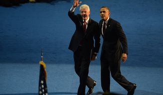 President Obama joins former President Bill Clinton onstage Sept. 5, 2012, after Clinton addressed the Democratic National Convention at the Time Warner Arena in Charlotte, N.C. (Andrew Geraci/The Washington Times)