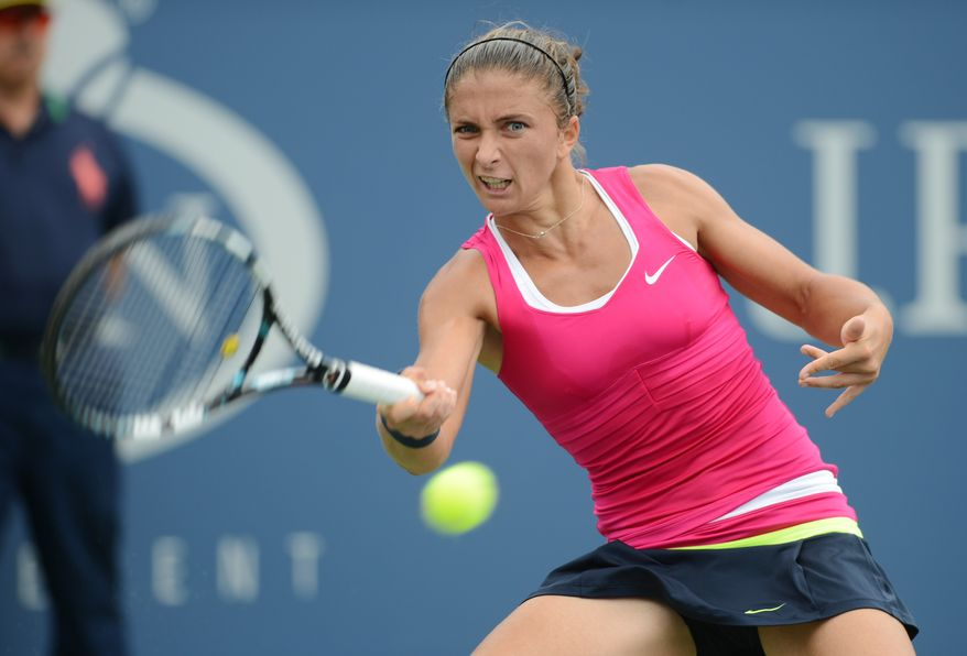 Italy's Sara Errani returns a shot to fellow Italian Roberta Vinci in the quarterfinals of the 2012 US Open tennis tournament, Wednesday, Sept. 5, 2012, in New York. (AP Photo/Henny Ray Abrams)