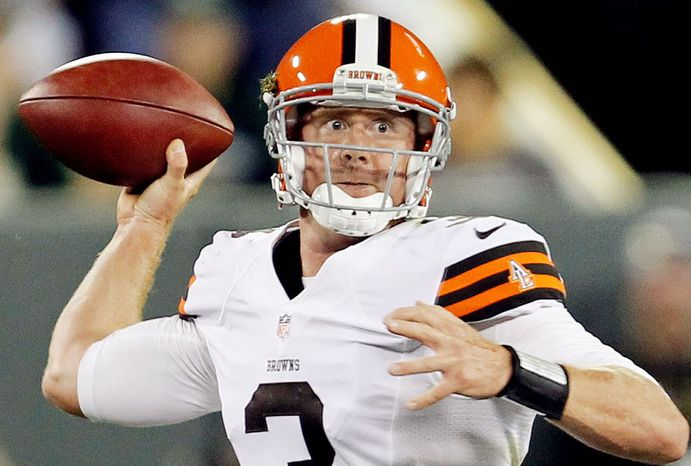 Cleveland Browns quarterback Brandon Weeden throws during the first half of a preseason NFL football game against the Green Bay Packers Thursday, Aug. 16, 2012, in Green Bay, Wis. (AP Photo/Mike Roemer)