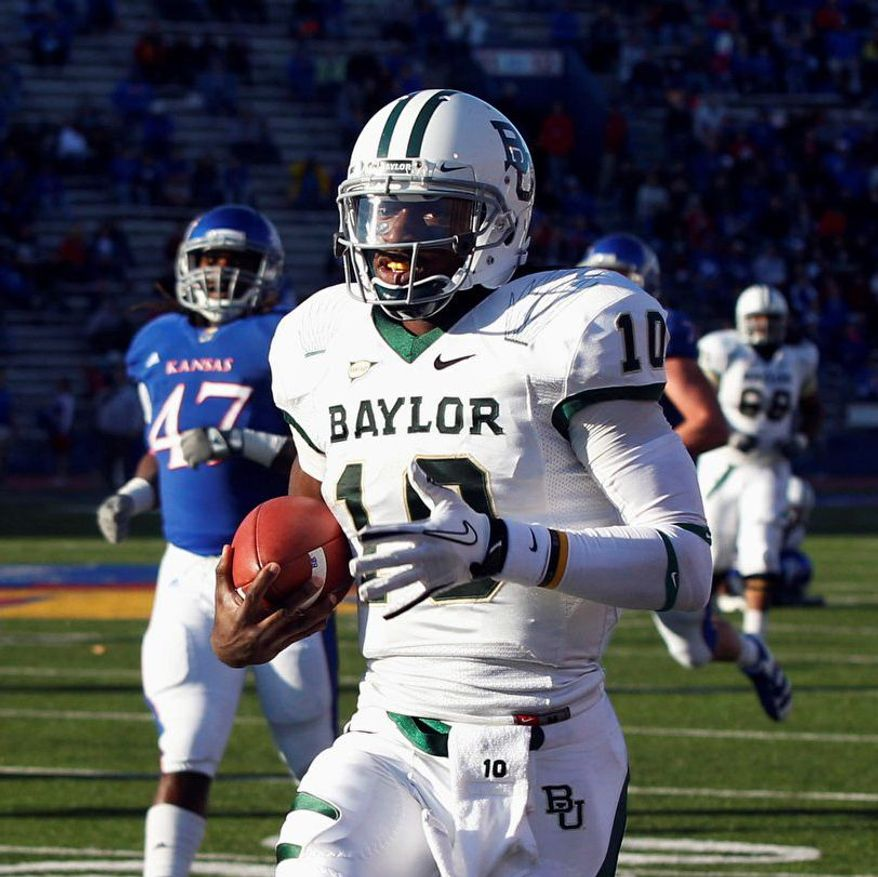 FOR USE AS DESIRED WITH NFL DRAFT STORIES - FILE - In this Nov. 12, 2011, file photo, Baylor quarterback Robert Griffin III (10) runs for a touchdown during the second half of an NCAA college football game against Kansas in Lawrence, Kan. Griffin is a top prospect in the upcoming NFL football draft. (AP Photo/Orlin Wagner, File)