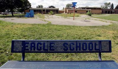 A bench adds to the serenity of former Eagle Elementary School in West Bloomfield, Mich. The Farmington Hills school district defends its agreement to sell the school to a Muslim association that wants to establish a mosque. (Associated Press)