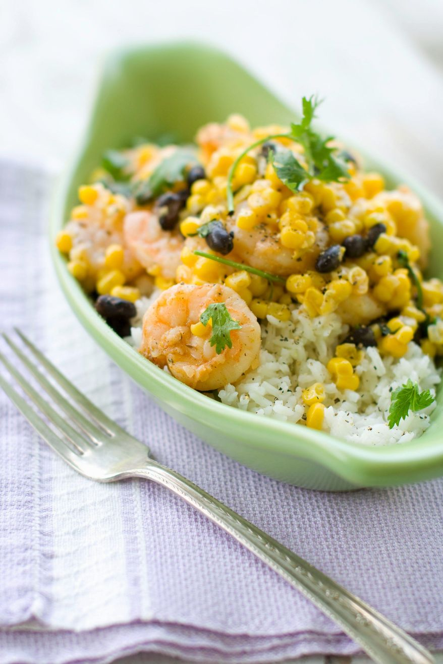 Grilled fiesta shrimp recipe with black bean and corn. (Associated Press)
