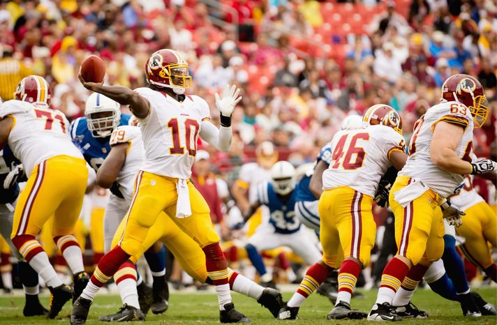 The Redskins drafted quarterback Robert Griffin III (above) and brought in wide receivers Pierre Garcon and Josh Morgan in an attempt to improve an offense that was 20th in the NFL in yards per play in 2011. (Andrew Harnik/The Washington Times)