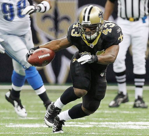 New Orleans Saints running back Darren Sproles (43) runs up field as Detroit Lions outside linebacker Justin Durant (52) and Detroit Lions defensive tackle Nick Fairley (98) defend during the second half of an NFL wild card playoff football game Saturday, Jan. 7, 2012, in New Orleans. (AP Photo/Gerald Herbert)