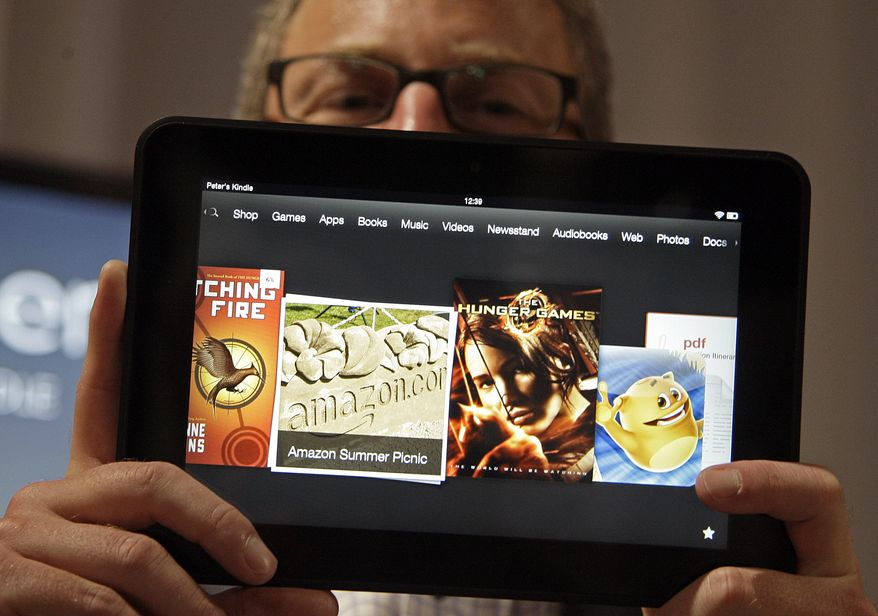 Amazon Kindle vice president Peter Larsen holds the Kindle Fire HD at the introduction of the new Kindle devices in Santa Monica, Calif., on Sept. 6, 2012. (Associated Press)