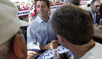 Rep. Paul Ryan, the Republican vice presidential candidate, greets supporters during a campaign event at the Dallas County Courthouse in Adel, Iowa, on Wednesday, Sept. 5, 2012. (AP Photo/Mary Altaffer)