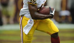 Washington Redskins running back Alfred Morris (46) carries the ball during warmups before a preseason NFL football game against the Indianapolis Colts, Saturday, Aug. 25, 2012, in Landover, Md. (AP Photo/Nick Wass)