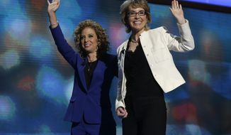 Former Rep. Gabrielle Giffords (right) reacts Sept. 6, 2012, after reciting the Pledge of Allegiance with Democratic National Committee Chairwoman Rep. Debbie Wasserman Schultz of Florida at the Democratic National Convention in Charlotte, N.C. (Associated Press)