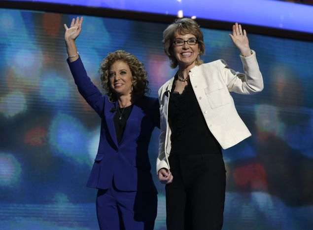 Former Rep. Gabrielle Giffords (right) reacts Sept. 6, 2012, after reciting the Pledge of Allegiance with Democratic National Committee Chairwoman Rep. Debbie Wasserman Schultz of Florida at the Democratic National Convention in Ch
