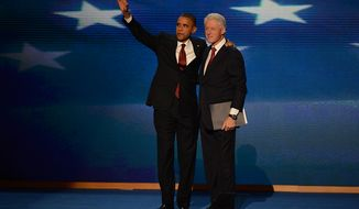 President Obama joins former President Bill Clinton after Clinton addressed the Democratic National Convention at the Time Warner Arena in Charlotte, N.C., on Sept. 5, 2012. (Andrew Geraci/The Washington Times)