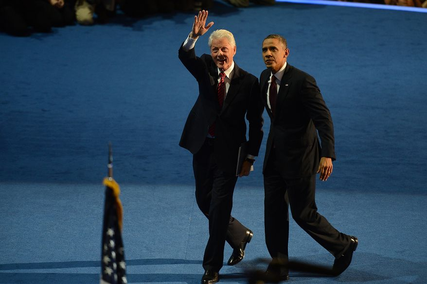 President Barack Obama joins the 42nd President of the United States, after Clinton addressed the Democratic National Convention at the Time Warner Arena in Charlotte, N.C., on Wednesday, September 5, 2012.