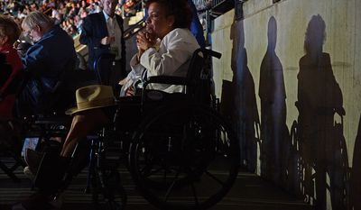 Army veteran Barbara Heron of Accokeek, Md., watches speeches on the second night of the Democratic National Convention at the Time Warner Arena in Charlotte, N.C., on Wednesday, September 5, 2012. (Barbara Salisbury/ The Washington Times)