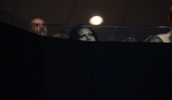First Lady Michelle Obama waits for former President Bill Clinton to address the Democratic National Convention at the Time Warner Arena in Charlotte, N.C., on Wednesday, September 5, 2012. (Barbara Salisbury/ The Washington Times)