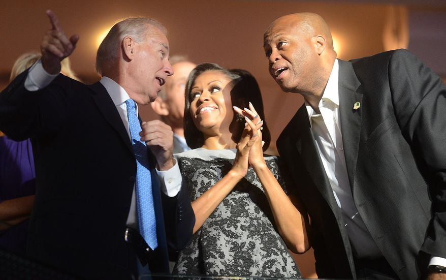 Vice-President Joe Biden talks with First Lady Michelle Obama and her brother Craig Robinson at the Democratic National Convention at the Time Warner Arena in Charlotte, N.C., on Wednesday, September 5, 2012. (Barbara Salisbury/ The Washington Times)