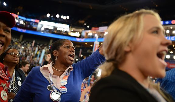 Virginia delegate Palma Young, of Stafford, Va., cheers during an address at the Democratic National Convention at the Time Warner Arena in Charlotte, N.C., on Wednesday, September 5, 2012. (Andrew Geraci/ The Washington Times)
