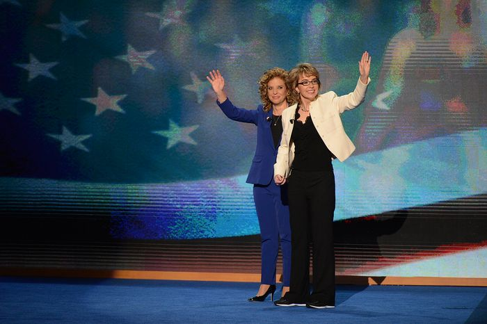 Rep. Debbie Wasserman Schultz, D- Fla., joins former Arizona Congresswoman Gabrielle Giffords in saying the Pledge of Allegiance on the night that President Barack Obama accepts his party's nomination for a second term as President of the United States at the Democratic National Convention in the Time Warner Cable Arena in Charlotte, N.C., on Thursday, September 6, 201
