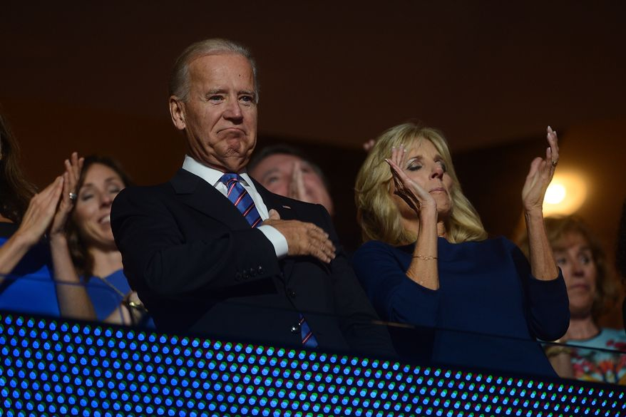 Vice President Joe Biden acknowledges his son Beau Biden, Attorney General of Delaware who placed his father's name in nomination for Vice President on the night that President Barack Obama accepts his party's nomination for a second term as President of the United States at the Democratic National Convention in the Time Warner Cable Arena in Charlotte, N.C., on Thursday, September 6, 2012. (Barbara Salisbury/ The Washington Times)