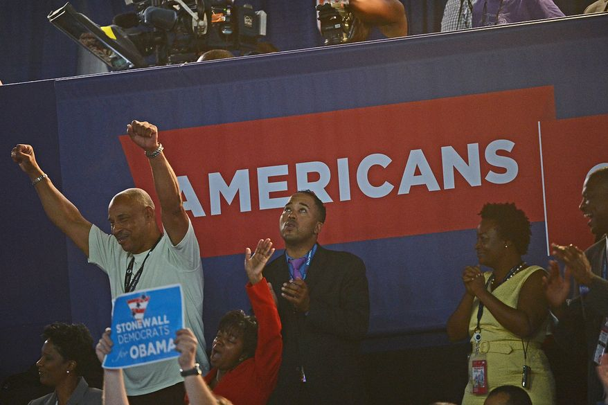 Democrats cheer on the night that President Barack Obama accepts his party's nomination for a second term as President of the United States at the Democratic National Convention in the Time Warner Cable Arena in Charlotte, N.C., on Thursday, September 6, 2012. (Andrew Geraci/ The Washington Times)