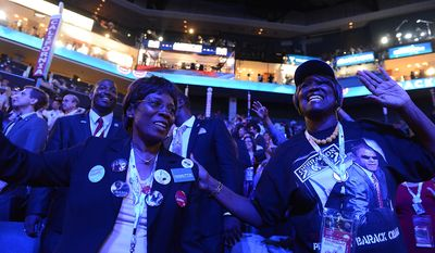 California delegates Dorothy Williams, of San Jose, Calif., left, and Rosa Russell, of Los Angeles, Calif. dance to the music of James Taylor on the night that President Barack Obama accepts his party's nomination for a second term as President of the United States at the Democratic National Convention in the Time Warner Arena in Charlotte, N.C., on Thursday, September 6, 2012. (Barbara Salisbury/ The Washington Times)