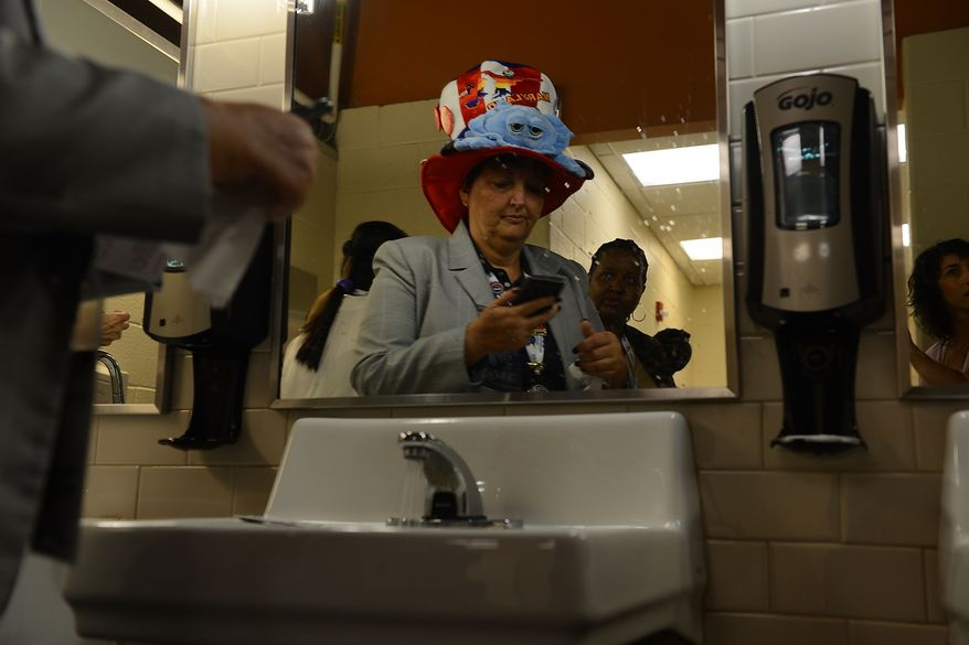Maryland delegate Laura Mitchell, of Salisbury, Md. checks her phone in a restroom before the last night of the Democratic National Convention in the Time Warner Arena in Charlotte, N.C., on Thursday, September 6, 2012. (Barbara Salisbury/ The Washington Times)