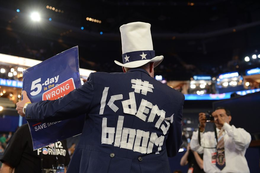 Colorado delegate Tim Kubic gets his photo taken at the Democratic National Convention in the Time Warner Arena in Charlotte, N.C., on Thursday, September 6, 2012. (Barbara Salisbury/ The Washington Times)
