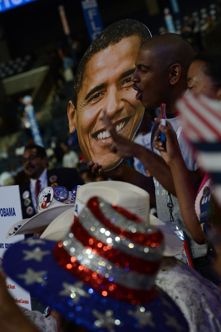 Florida delegate Corey Wilborn, of Jacksonville, Fla., carries a giant Obama head on the night that President Barack Obama accepts his party's nomination for a second term as President of the United States at the Democratic National Convention in the Time Warner Arena in Charlotte, N.C., on Thursday, September 6, 2012. (Barbara Salisbury/ The Washington Times)