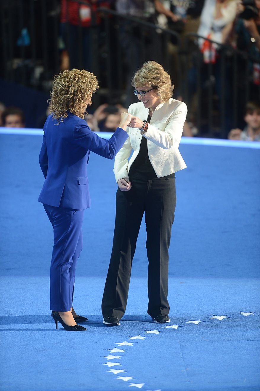 Rep. Debbie Wasserman Schultz, D- Fla., joins former Arizona Congresswoman Gabrielle Giffords in saying the Pledge of Allegiance on the night that President Barack Obama accepts his party's nomination for a second term as President of the United States at the Democratic National Convention in the Time Warner Cable Arena in Charlotte, N.C., on Thursday, September 6, 2012. (Barbara Salisbury/ The Washington Times)