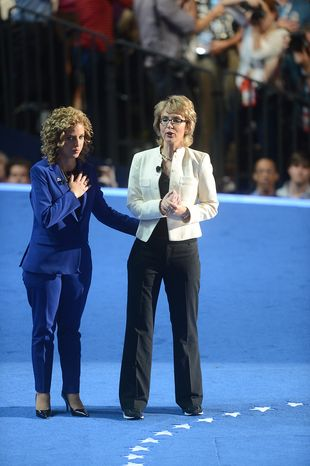 Rep. Debbie Wasserman Schultz, D- Fla., joins former Arizona Congresswoman Gabrielle Giffords in saying the Pledge of Allegiance on the night that President Barack Obama accepts his party's nomination for a second term as President of the United States at the Democratic National Convention in the Time Warner Cable Arena in Charlotte, N.C., on Thursday, September 6, 2012.(Barbara Salisbury/ The Washington Times)