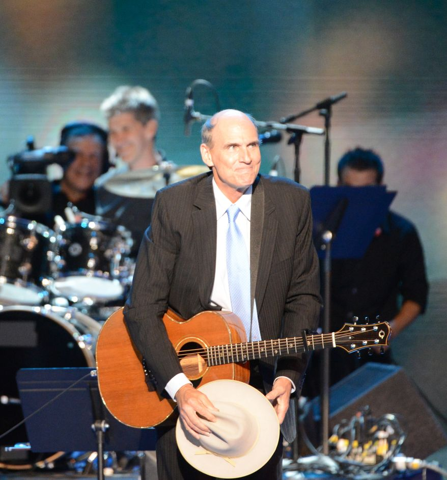 James Taylor performs during the Democratic National Convention at the Time Warner Arena. (Andrew Geraci/ The Washington Times)