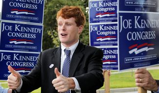 Joseph Kennedy III, son of former U.S. Rep. Joseph P. Kennedy II and grandson of late Sen. Robert F. Kennedy, gestures Thursday while visiting voters outside a polling station at a school in Needham, Mass. He won the Democratic primary election for the House seat being vacated by U.S. Rep. Barney Frank. (Associated Press)